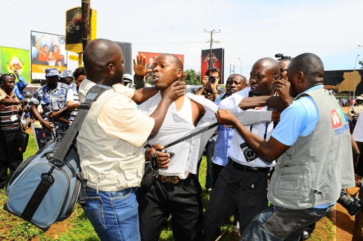 Journalists took the law into their hands and manhandled a man masquerading as a journalist. He was whisked away by plane clothed security men